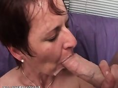 Nasty brunette milf blows stiff cock