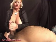 Big tit domina gives a guy a handjob