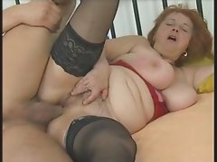Busty chubby mature in stockings sucks..