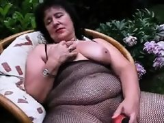 Thick granny masturbates with a dildo..
